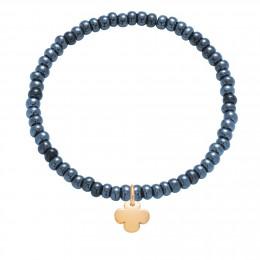 Náramek s pozlaceným oválným čtyřlístkem na křišťálových, tmavě modrých korálcích s opalizací